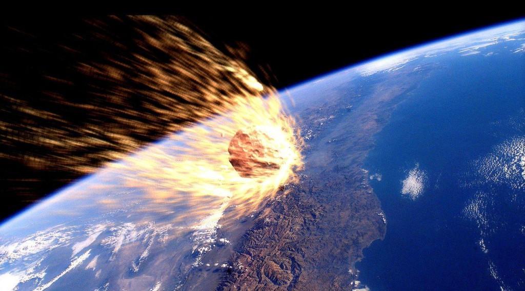 Recreación artística de un astereroide entrando en la artmósfera terrestre